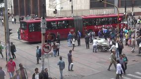 Urban Intersection, Traffic, Pedestrians. Stock video of an intersection stock footage