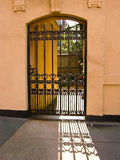 Urban Iron Gate. Iron gate into an urban entryway to the courtyard Stock Photo