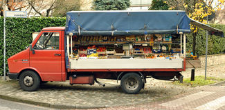Urban italy streets vegetables car market Royalty Free Stock Images