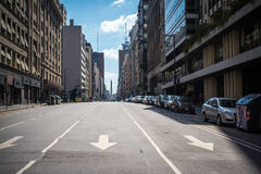 Urban landscape of the Argentine city. Shevelev. Urban landscape of the Argentine city. Buildings with shops on both sides of the road. Cars parked on the royalty free stock photo
