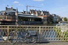 Urban landscape in Belgium. View from the bridge, vintage bicycle in the foreground Stock Image