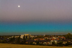 Urban landscape at blue hour by full moon Stock Photography
