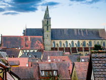 Urban landscape with a church of St. Jakob in the background. Rothenburg, Bavaria, Germany Royalty Free Stock Photos
