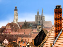 Urban landscape with a church of St. Jakob in the background. Rothenburg, Bavaria, Germany Royalty Free Stock Images