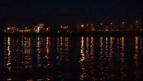 Urban landscape with city lights reflected in water in the evening at night. Urban landscape with city lights reflected in water in the evening on background of stock video footage