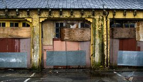 Urban landscape of decay. Urban landscape of decay showing dilapidated building. Image shows pastel toning. Horizontal orientation Stock Images