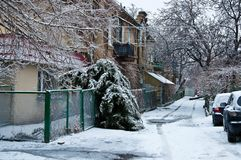 Urban landscape in frosty winter season. Winter scene with old houses and snowy tire tracks in Odessa Ukraine. Icy weather cityscape stock photo