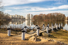 Urban landscape with lake. Spring cityscape with lake and dock Royalty Free Stock Images
