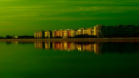 Urban landscape with lake at sunset.Mirror-like lake stock footage
