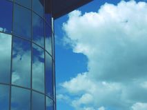 Modern building on a background of clouds. Royalty Free Stock Photography