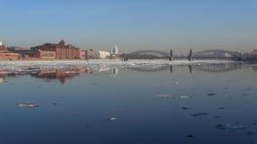 Urban landscape near Bolsheokhtinsky bridge during the spring ice drift. Saint-Petersburg. Urban landscape near Bolsheokhtinsky bridge during the spring ice stock footage