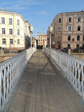 Urban landscape pedestrian bridge from river building and cars Royalty Free Stock Photo