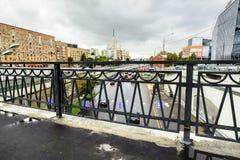 Urban landscape on rainy day. View of the Yauza river embankment through the bridge Visokoyauzskiy, Moscow, Russia. stock image