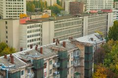 The urban landscape, residential buildings and the administrative building of the factory in an industrial style.  royalty free stock images