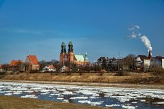 Urban landscape with river Warta and the cathedral towers Royalty Free Stock Photos