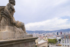 Urban landscape with seated statue. View of the Plaza de españa in Barcelona Royalty Free Stock Images
