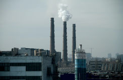 Urban landscape with smokestacks and industrial factory Royalty Free Stock Photo