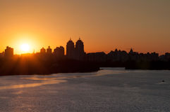 Urban landscape during sunset. A large expanse of water. Urban landscape during sunset royalty free stock photography