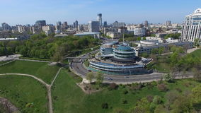 Urban landscape traffic cars and buildings near the park nature sights of the Kiev. Aerial in spring sunny weather stock footage