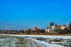 Urban Landscape With River Warta And The Cathedral Towers In Winter Stock Photos