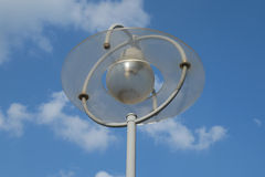 Urban lantern on a background of blue sky and white clouds royalty free stock image