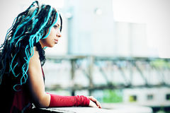 Urban life. Portrait of a stylish young woman with dreadlocks Stock Image