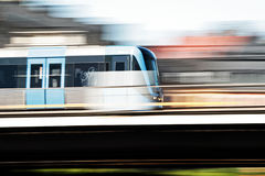 Urban life. Subway train passing by with high speed royalty free stock photos