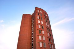 Urban life. Red brick building on blue sky Stock Photography
