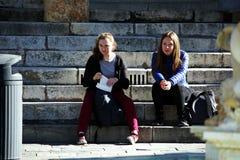 Urban life. Girls sitting in the sun 7 Stock Image