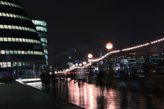 Urban life in  london, city hall. Night scenes of urban life in london, england, with city hall on the left Royalty Free Stock Photo
