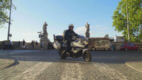 Urban life, motorcyclists riding past Mausoleum of Hadrian in Rome, tourism. Stock footage stock video footage