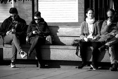 Urban life - people sitting outdoors - Monocolor Royalty Free Stock Photography