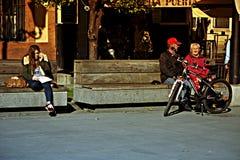 Urban life People sitting in the sun 3 Stock Image