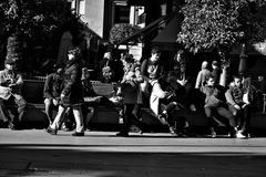 Urban life People sitting in the sun 4 Stock Photography