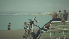 Urban life in resort town, people walking on embankment and enjoying life. Stock footage stock video