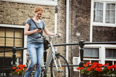 Urban Life - Woman with Bicycle Royalty Free Stock Images