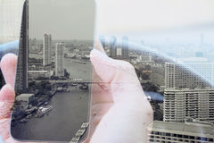 Urban lifestyle and Business technology concept. Double exposure of man using smart phone and cityscape background, urban lifestyle and Business technology stock photos