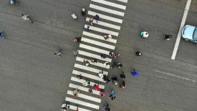 Urban lifestyle. People crowd on pedestrian crosswalk. Zebra crossing, top view. Urban lifestyle. People crowd on pedestrian crosswalk. Zebra crossing, top view royalty free stock photo