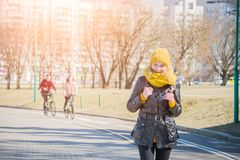 Urban lifestyle people at Harbour, Woman tourist with student backpack in city outdoors enjoying autumn or spring season. Alone in sidewalk stock photography