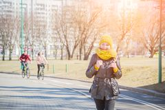 Urban lifestyle people at Harbour, Woman tourist with student backpack in city outdoors enjoying autumn or spring season. Alone in sidewalk stock image