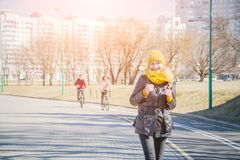 Urban lifestyle people at Harbour, Woman tourist with student backpack in city outdoors enjoying autumn or spring season. Alone in sidewalk royalty free stock images