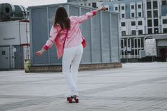 Hipster girl enjoying skating on penny board stock photos