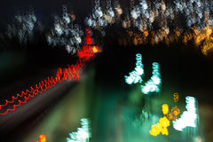 Urban Lights. Colored lights seen at evening and during night with motion blur caused by free hand hold camera, creating waves of light, long time photography Stock Photos