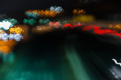 Urban Lights. Colored lights seen at evening and during night with motion blur caused by free hand hold camera, creating waves of light, long time photography Stock Image