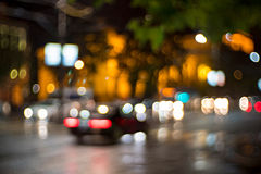 Urban lights. Defocused blur image of cars and city lights at night royalty free stock photos