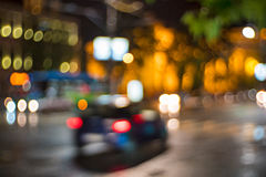 Urban lights. Defocused blur image of cars and city lights at night stock photos