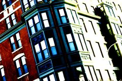Urban living. Edgy high-contrast slanted image of apartment building downtown royalty free stock photo