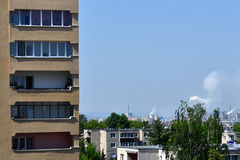Urban Living. Apartment buildings and industrial complex on the horizon in Târgu Mureș, Romania Stock Images