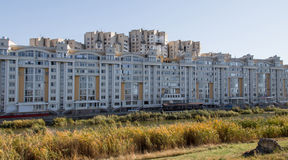 Urban living in a block of flats behind a lake Royalty Free Stock Photography
