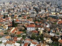 Urban living - houses and roofs of city. Urban living - aerial view of roofs, gardens and houses of city Athens, Greece Royalty Free Stock Photos